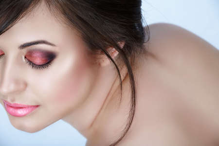 Beautiful brunette woman with pink smoky eyes eyeshadow and soft smile � natural make-up with good skin texture  photo