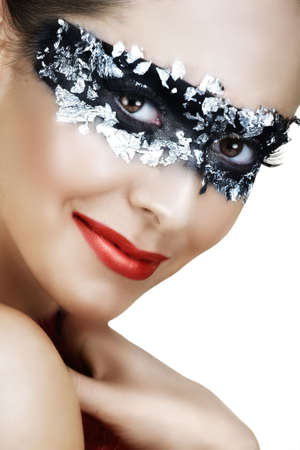 Beautiful woman with red lips and silver leaf mask on black smiling Stock Photo - 3471386