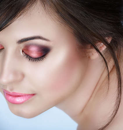Beautiful brunette woman with pink smoky eyes eyeshadow and soft smile � natural make-up with good skin texture  Stock Photo
