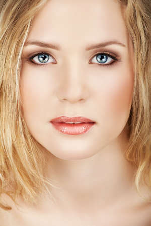 smoky eyes: Blond beautiful woman face close-up with natural make-up � good clean skin texture  Stock Photo