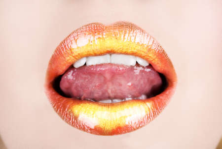 Full open mouth with naughty tongue and gold orange lipstick  Stock Photo - 4128740
