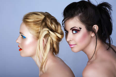 Two beautiful young women with fashion make-up and modern hairstyle Ð not isolated Stock Photo - 4241398