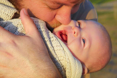 son and father  outside in evening sun- shot in natural light. Stock Photo - 4871914