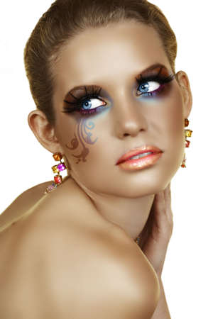 tanned blond woman with artistic make-up - swirls on her cheek are digitally applied from my photo Stock Photo - 4871919