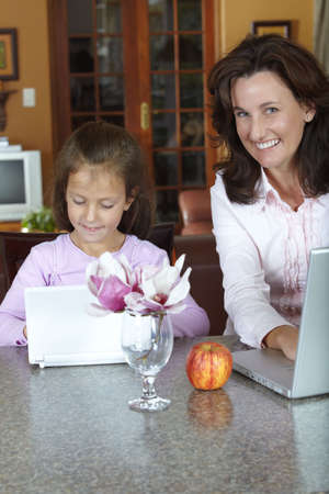daughter working on laptops on a home background Stock Photo - 5353255