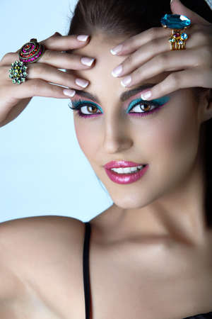 Beautiful young Italian woman with fashion make-up and cocktail rings from 16Bit RAW.