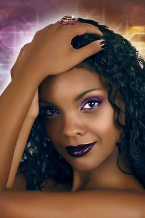 Beautiful African woman with long curly hair, pink smoky eyeshadow and purple lips on disco background. Stock Photo - 6813821