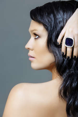 woman with black hair and ring on black manicure hand, from 16Bit RAW Stock Photo - 6985336