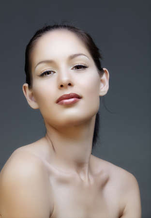 full face: Beautiful natural make-up brunette woman with pink lips and liquid liner, from 16Bit RAW.