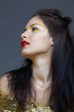beautiful brunette woman with long hair and red lips, from 16Bit RAW. photo
