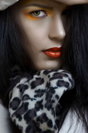 woman with bright orange eyeshadows make-up and red lips