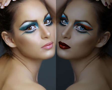 avantgarde: Beautiful brunette woman with cat eyes make-up in turquoise and white, with a double reflection.