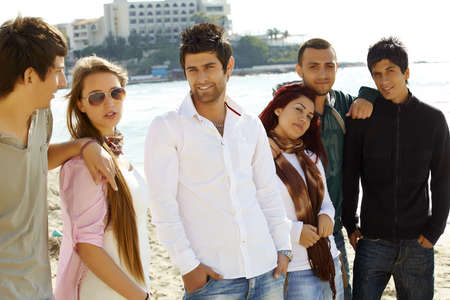 turkish man: group of young turkish friends relaxing on the beach at a sea resort