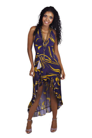 party dress: Beautiful African woman with long curly hair in purple halter neck dress and purple make-up. Stock Photo