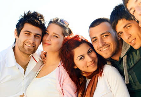 turkish man: young Turkish student group of friends in a row with faces close
