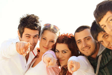young Turkish student group of friends in a row  photo