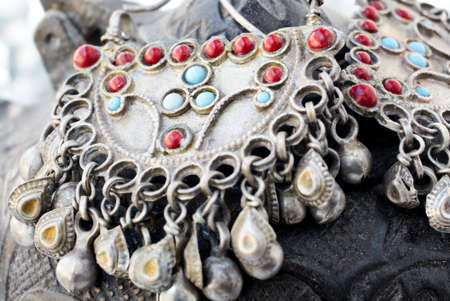 bijoux: 200 years old antique Turkish silver earrings with red and blue beads - shallow DOF. Stock Photo