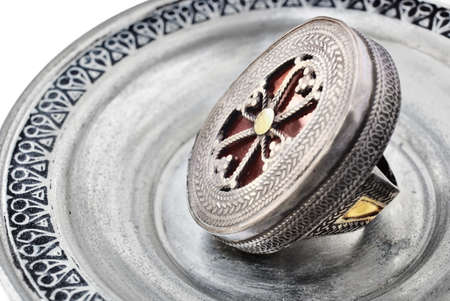 bijoux: Turkish antique 200 years old silver ring with cross symbol on silver plate background Stock Photo