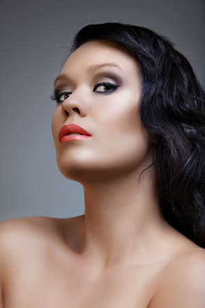 beautiful woman with long black hair, coral lips and smoky bright eyeshadow, from 16Bit RAW Stock Photo - 8215874
