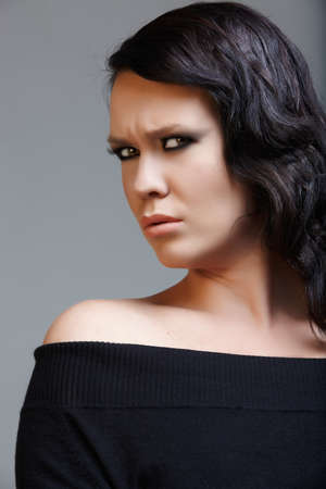angry beautiful woman with long black hair from 16 bit RAW Stock Photo - 7602049