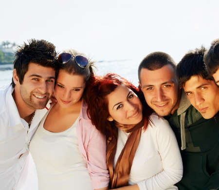 young Turkish student group of friends in a row with faces close at the sea photo