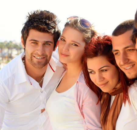 young Turkish student group of friends in a row with faces close photo
