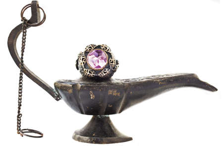 Turkish Ottoman silver and gold vintage ring with amethyst on antique oil lamp. photo