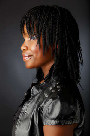 beautiful African woman with braids in black leather jacket Stock Photo - 7791325