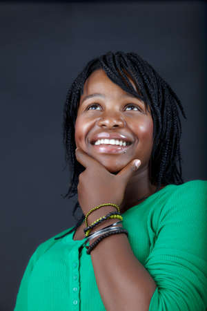 beautiful African student in a green top dreaming with a smile Stock Photo - 7791329