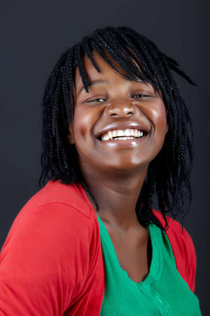 beautiful African woman in a green top smiling with confidence photo