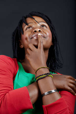 beautiful African student in a green top dreaming with a smile Stock Photo - 7791324