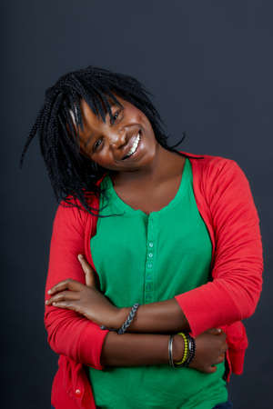 beautiful African student in a green top smiling with confidence Stock Photo - 7791327