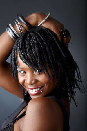 plait: beautiful African woman with bracelets smiling with confidence