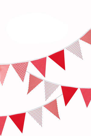 festive red and white bunting flags on white background with space for text