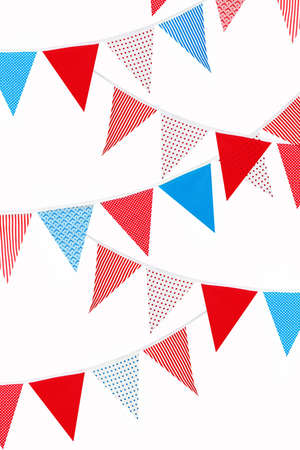 festive red, blue and white bunting flags on white background Banque d'images