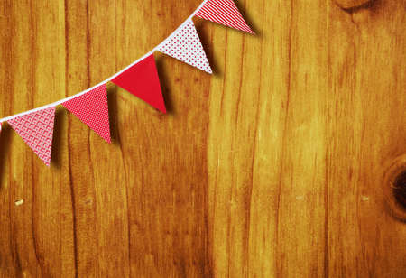 red and white festive flags on wood background with copy space