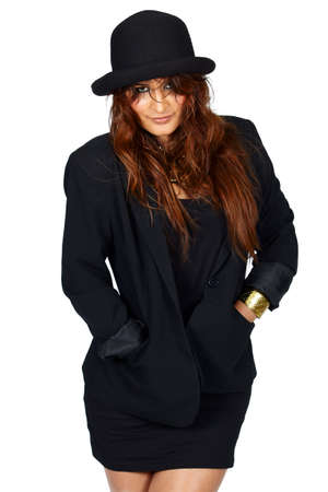 beautiful young LAtin American woman in trendy black jacket, mini skirt and hat. photo