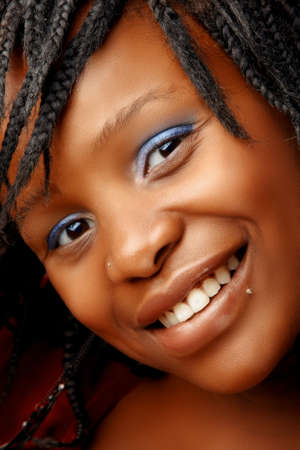 nosering: beautiful smiling African woman with natural make-up and facial piercings