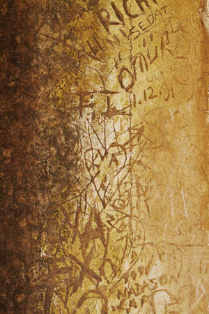 defaced ancient culture wall with carved graffiti in Ephesus, Turkey. photo