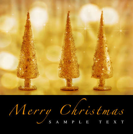 Christmas trees on gold background