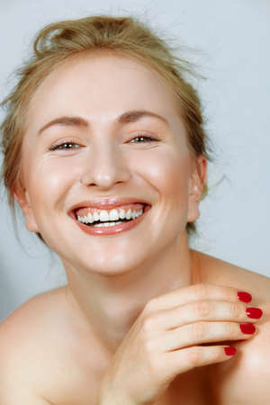 laughing beautiful young woman with fine laugh lines around her eyes. photo