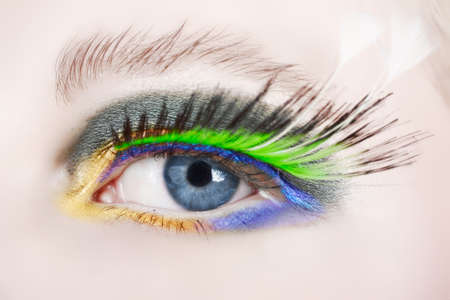 macro shot of an eye with long false feather lashes and bright fashion make-up photo