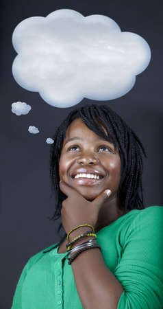 beautiful African student in a green top dreaming with a thought bubble Stock Photo - 8215932