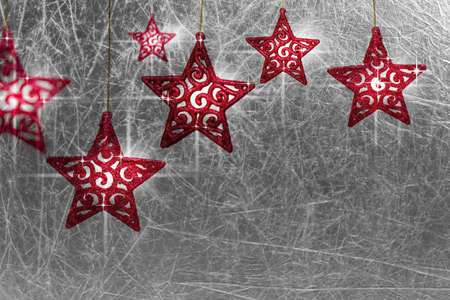 red christms stars on metallic textured silver background with empty space Stock Photo - 8216050