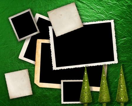 green metallic background with grunge photo frames with Christmas trees and space for text. photo
