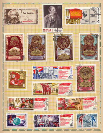 a collection of Soviet Union postage stamps with seals dedicated to socialist labor and adorned with slogans, 1970s photo