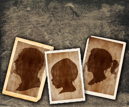 family portraits in vintage silhouette design in old picture frames on grunge wall with copy space photo