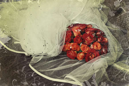 beautiful red roses in a bridal bouquet with copy space over white veil on grunge background Stock Photo - 8744658