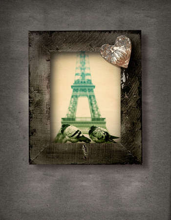 wooden grunge frame with two doves on the background of Eiffel Tower in Paris and a rustic heart. photo