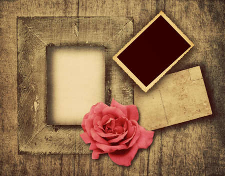 grunge wooden frame, postcard and a picture template with copy space and a pink rose  photo